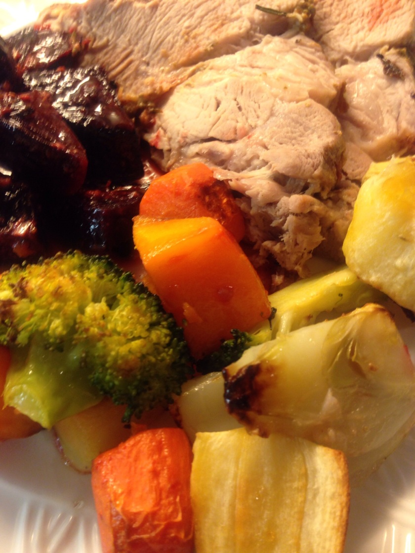 Herb and mustard pork with roast beetroot and vegetables