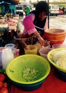 Making Som Tum - green pawpaw salad at Langkawi Food Markets