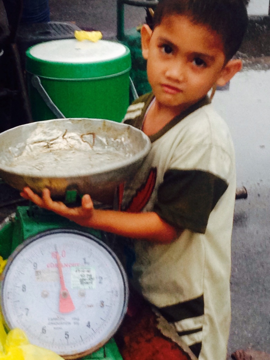 Weighing the fish at Langkawi  food markets