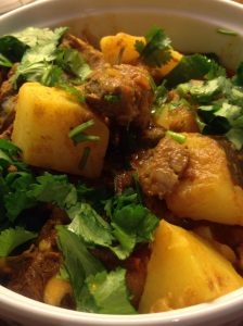 Lamb and potato curry garnished with coriander