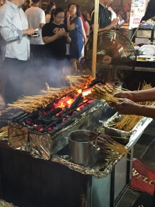 Charcoal grills set up for Satay Street market in front of Lau Pa Sat in Singapore