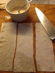 Cut spring roll pastry sheets into 3 equal strips