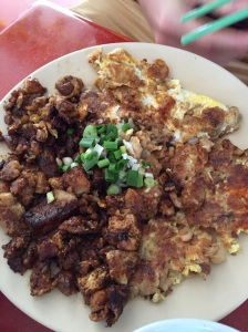 Carrot cake Singapore style - radish, onion, flour steamed then fried and scrambled with eggs.