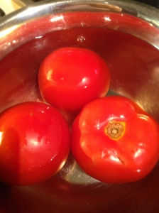 Soaking tomatoes in hot water makes it easier to peel the skin off