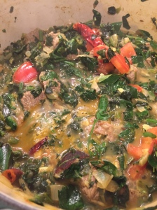 Simmer lamb and spinach mixture over medium heat until lamb is tender