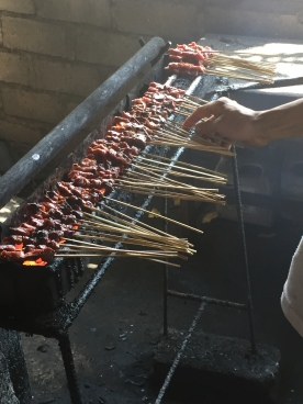 Satays freshly cooked on charcoal grill