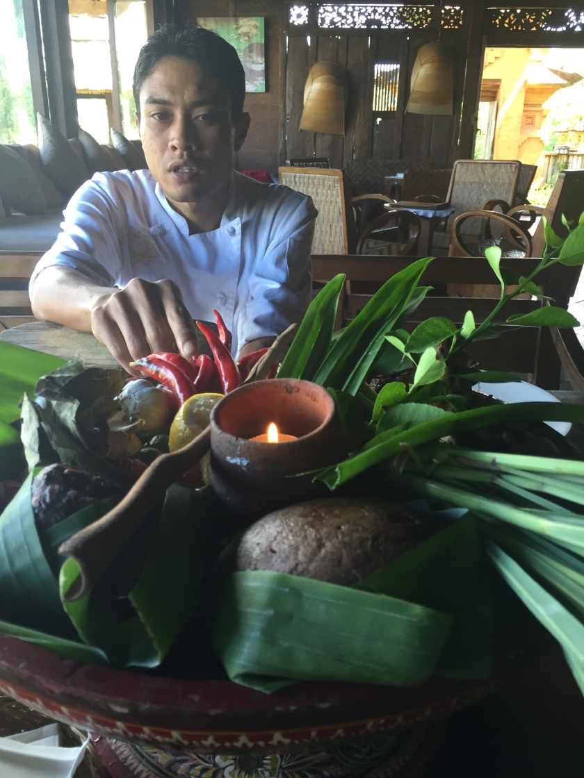 Chef Dewa explaining the herbs and spices to be used in our Balinese cooking class