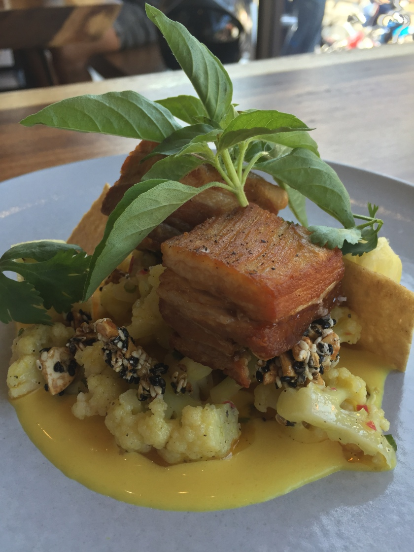 Crispy Pork Belly, turmeric dressing, cauliflower and dukkah spice